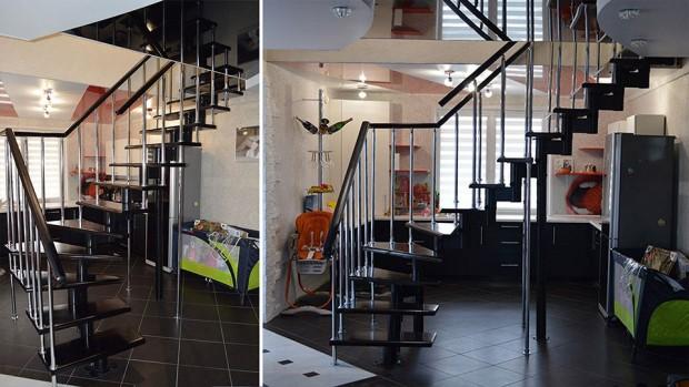 Лестница с чёрными ступенями и поручнем